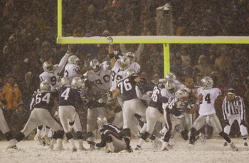 19 Jan 2002 : Adam Vinatieri #4 of the New England Patriots kicks the game winning field goal against the Oakland Raiders during the AFC Playoff game at Foxboro Stadium in Foxboro, Massachusettes. DIGITAL IMAGE. Mandatory Credit : Ezra Shaw/ Getty Images