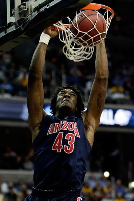 WASHINGTON - MARCH 20:  Jordan Hill #43 of the Arizona Wildcats dunks the ball against the West Virginia Mountaineers during the first round of the West Regional as part of the 2008 NCAA Men's Basketball Tournament at the Verizon Center on March 20, 2008