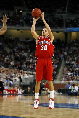 DETROIT - MARCH 28:  Stephen Curry #30 of the Davidson Wildcats attempts a shot against the Wisconsin Badgers during the Midwest Regional Semifinal of the 2008 NCAA Division I Men's Basketball Tournament at Ford Field on March 28, 2008 in Detroit, Michiga