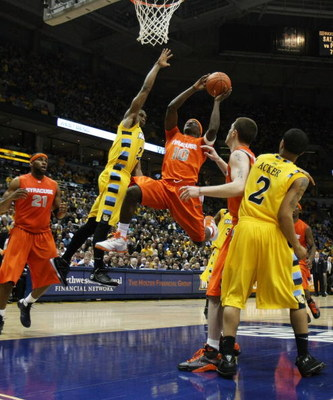 MILWAUKEE - MARCH 07: Jonny Flynn #10 of the Syracuse Orange drives to the basket past Jerel McNeal #22 of the Marquette Golden Eagles of the on March 7, 2009 at the Bradley Center in Milwaukee, Wisconsin. Syracuse defeated Marquette 86-79 in overtime. (P