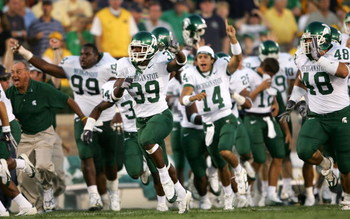 SOUTH BEND, IN - SEPTEMBER 17:  Running back Javon Ringer #39 of the Michigan State Spartans leads the bench onto the field in celebration after defeating the Notre Dame Fighting Irish in overtime on September 17, 2005 at Notre Dame Stadium in South Bend,
