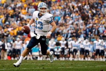 CHARLOTTE, NC - DECEMBER 27:  T.J. Yates #13 of the North Carolina Tar Heels runs with the ball against the West Virginia Mountaineers during the Meineke Car Care Bowl on December 27, 2008 at Bank of America Stadium in Charlotte, North Carolina.  (Photo b