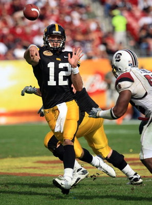 TAMPA, FL - JANUARY 01:  Ricky Stanzi #12 of the Iowa Hawkeyes drops back to pass against the South Carolina Gamecocks during the Outback Bowl on January 1, 2009 at Raymond James Stadium in Tampa, Florida.  (Photo by Scott Halleran/Getty Images)