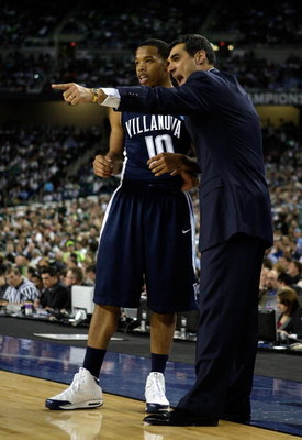 DETROIT - APRIL 04:  Head coach Jay Wright of the Villanova Wildcats gestures as he talks with Corey Fisher #10 in the first half against the North Carolina Tar Heels during the National Semifinal game of the NCAA Division I Men's Basketball Championship