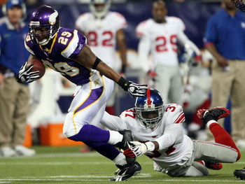 MINNEAPOLIS - DECEMBER 28:   Chester Taylor #29 of the Minnesota Vikings carries the ball for a first down as James Butler #37 of the New York Giants defends on December 28, 2008 at the Hubert H. Humphrey Metrodome in Minneapolis, Minnesota. The Vikings d