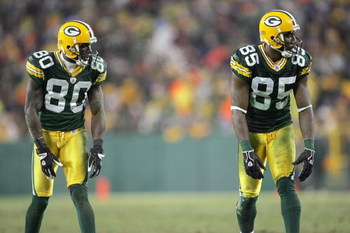 GREEN BAY, WI - DECEMBER 21: Donald Driver #80 and Greg Jennings #85 of the Green Bay Packers gets ready to move at the snap during the game against the Minnesota Vikings on December 21, 2006 at Lambeau Field in Green Bay, Wisconsin. The Packers defeated