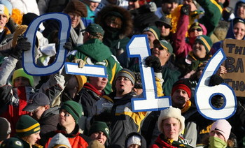 GREEN BAY, WI - DECEMBER 28: Fans hold signs indicating the impending record of the Detroit Lions during a game between the Lions and the Green Bay Packers on December 28, 2008 at Lambeau Field in Green Bay, Wisconsin. The Packers defeated the Lions 31-21