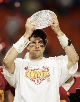 MIAMI - JANUARY 4:  Quarterback Matt Leinart #11 of the USC Trojans holds up the championship trophy after defeating the Oklahoma Sooners 55-19 to win the FedEx Orange Bowl 2005 National Championship on January 4, 2005 at Pro Player Stadium in Miami, Flor