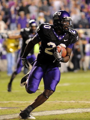 FORT WORTH, TX - OCTOBER 16:  Cornerback Nick Sanders #20 of the TCU Horned Frogs makes a pass interception in the endzone against Austin Collie #9 of the BYU Cougars at Amon G. Carter Stadium on October 16, 2008 in Fort Worth, Texas.  (Photo by Ronald Ma