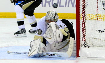 RALEIGH, NC - MAY 23:  Goaltender Marc-Andre Fleury #29 of the Pittsburgh Penguins defends against a shot by the Carolina Hurricanes during Game Three of the Eastern Conference Championship Round of the 2009 Stanley Cup Playoffs at RBC Center on May 23, 2