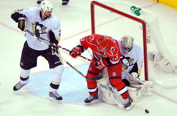 RALEIGH, NC - MAY 23:  Hal Gill #2 of the Pittsburgh Penguins defends against Ray Whitney #13 as goaltender Marc-Andre Fleury #29 protects the goal during Game Three of the Eastern Conference Championship Round of the 2009 Stanley Cup Playoffs at RBC Cent