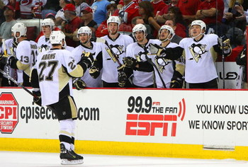 RALEIGH, NC - MAY 23:  Craig Adams #27 of the Pittsburgh Penguins celebrates his empty-netter against the Carolina Hurricanes during Game Three of the Eastern Conference Championship Round of the 2009 Stanley Cup Playoffs at RBC Center on May 23, 2009 in 