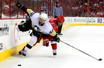 RALEIGH, NC - MAY 23:  Chad LaRose #59 of the Carolina Hurricanes battles for the puck against Tyler Kennedy #48 of the Pittsburgh Penguins during Game Three of the Eastern Conference Championship Round of the 2009 Stanley Cup Playoffs at RBC Center on Ma