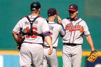 WASHINGTON - SEPTEMBER 16:  Chipper Jones #10 of the Atlanta Braves congratulates Tim Hudson #15 after beating the Washington Nationals 3-0 at RFK Stadium September 16, 2007 in Washington, DC.   Hudson pitched a complete game shutout. (Photo by Greg Fiume