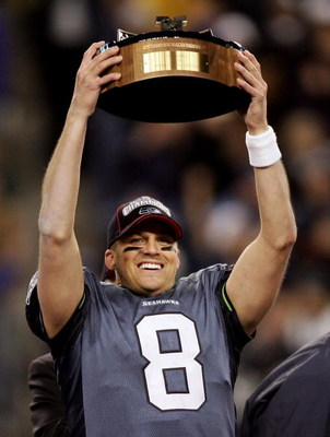 SEATTLE - JANUARY 22:  Quarterback Matt Hasselbeck holds up the NFC Championship trophy following his team's victory over the Carolina Panthers at Qwest Stadium on January 22, 2006 in Seattle, Washington. Seattle will play Pittsburgh in Super Bowl XL.  (P