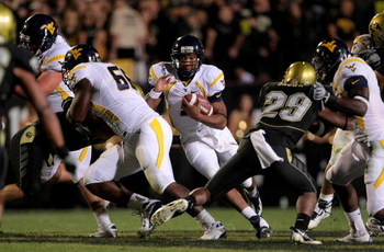 BOULDER, CO - SEPTEMBER 18:  Quarterback Pat White #5 of the West Virginia Mountaineers rushes against the Colorado Buffaloes at Folsom Field September 18, 2008 in Boulder, Colorado. Colorado defeated West Virginia 17-14 in overtime.  (Photo by Doug Pensi