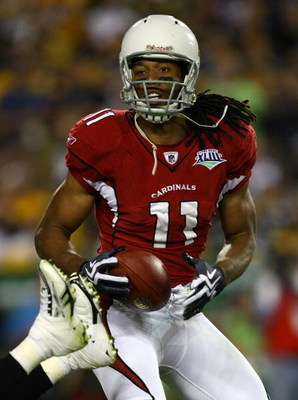 TAMPA, FL - FEBRUARY 01:  Larry Fitzgerald #11 of the Arizona Cardinals catches the ball against the Pittsburgh Steelers during Super Bowl XLIII on February 1, 2009 at Raymond James Stadium in Tampa, Florida.  (Photo by Jamie Squire/Getty Images)