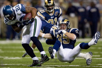 ST. LOUIS, MO - DECEMBER 14:  Todd Johnson #35 of the St. Louis Rams tackles Julius Jones #22 of the Seattle Seahawks at the Edward Jones Dome on December 14, 2008 in St. Louis, Missouri.  (Photo by Dilip Vishwanat/Getty Images)