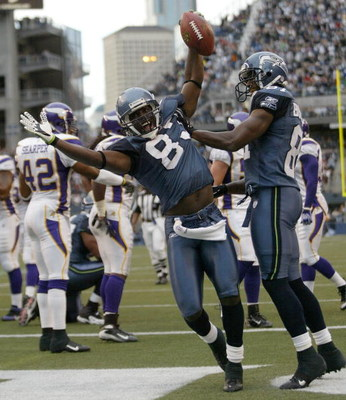 SEATTLE - AUGUST 25:  Wide receiver Nate Burleson #81 of the Seattle Seahawks celebrates an apparent touchdown with Deion Branch #83 during a preseason game against the Minnesota Vikings at Qwest Field August 25, 2007 in Seattle, Washington. Burleson was