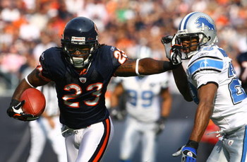 CHICAGO - NOVEMBER 02:  Devin Hester #23 of the Chicago Bears stiff arms Leigh Bodden #28 of the Detroit Lions during the first quarter at Soldier Field on November 2, 2008 in Chicago, Illinois. The Bears defeated the Lions 27-23.  (Photo by Jeff Gross/Ge