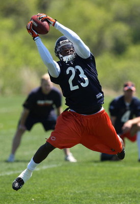 LAKE FOREST, IL - MAY 20: Devin Hester #23 of the Chicago Bears leaps to catch a pass during an organized team activity (OTA) practice on May 20, 2009 at Halas Hall in Lake Forest, Illinois. (Photo by Jonathan Daniel/Getty Images)