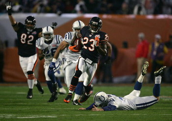 MIAMI GARDENS, FL - FEBRUARY 04:  Kick returner Devin Hester #23 of the Chicago Bears returns the opening kickoff 92-yards for a touchdown past a diving Adam Vinatieri #4 of the Indianapolis Colts in the first quarter of Super Bowl XLI on February 4, 2007