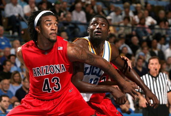 WESTWOOD, CA - JANUARY 15:  Alfred Aboya #12 of the UCLA Bruins battles for position with  Jordan Hill #43 of the Arizona Wildcats during the college basketball game at Pauley Pavilion on January 15, 2009 in Westwood, California. The Bruins defeated the W