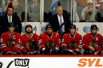 CHICAGO - MAY 24:  (L-R) Jonathan Toews #19, Adam Burish #37, Dustin Byfuflien #33, head coach Joel Quenneville, Kris Versteeg #32 and Patrick SHarp #10 of the Chicago Blackhawks look on from the bench dejected late in the game against the Detroit Red Win