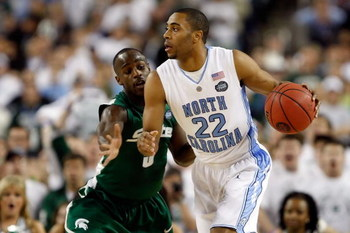 DETROIT - APRIL 06:  Wayne Ellington #22 of the North Carolina Tar Heels drives on Travis Walton #5 of the Michigan State Spartans during the 2009 NCAA Division I Men's Basketball National Championship game at Ford Field on April 6, 2009 in Detroit, Michi