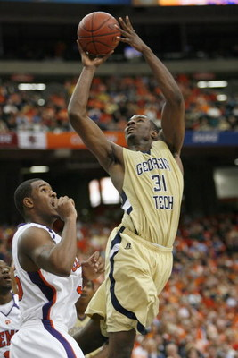 ATLANTA - MARCH 12:  Gani Lawal #31 of the Georgia Tech Yellow Jackets puts a shot up against the Clemson Tigers during day one of the 2009 ACC Men's Basketball Tournament on March 12, 2009 at the Georgia Dome in Atlanta, Georgia.  (Photo by Kevin C. Cox/