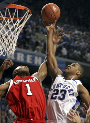 LEXINGTON, KY - DECEMBER 17:  Sheray Thomas #23 of the Kentucky Wildcats shoots the ball while defended by Terrance Williams #1 of the Louisville Cardinals during the game at Rupp Arena on December 17, 2005 in Lexington, Kentucky. Kentucky upset the 4th r