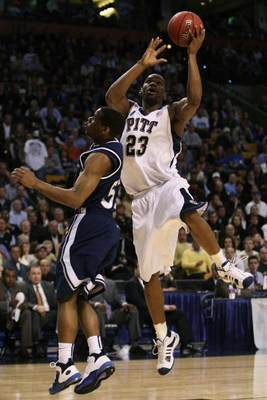 BOSTON - MARCH 26:  Sam Young #23 of the Pittsburgh Panthers drives to the hoop against Terell Holloway #52 of the Xavier Musketeers during the NCAA Men's Basketball Tournament East Regionals at TD Banknorth Garden on March 26, 2009 in Boston, Massachuset
