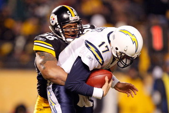 PITTSBURGH - JANUARY 11:  LaMarr Woodley #56 of the Pittsburgh Steelers sacks Philip Rivers #17 of the San Diego Chargers in the fourth quarter during their AFC Divisional Playoff Game on January 11, 2009 at Heinz Field in Pittsburgh, Pennsylvania. Steele