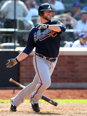 NEW YORK - MAY 13:  Brian McCann #16 of the Atlanta Braves bats against the New York Mets on May 13, 2009 at Citi Field in the Flushing neighborhood of the Queens borough of New York City. The Braves defeated the Mets 8-7 in twelve innings.  (Photo by Jim