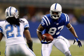 INDIANAPOLIS - DECEMBER 14:  Reggie Wayne #87 of the Indianapolis Colts looks to get past Travis Fisher #21 of the Detroit Lions on December 14, 2008 at Lucas Oil Stadium in Indianapolis, Indiana.  (Photo by Chris Graythen/Getty Images)