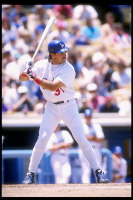 2 Jul 1995:  Catcher Mike Piazza of the Los Angeles Dodgers at bat during a game against the Colorado Rockies at Dodger Stadium in Los Angeles, California.  The Rockies won the game 10-1. Mandatory Credit: Stephen Dunn  /Allsport