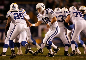 SAN DIEGO - JANUARY 03:  Quarterback Peyton Manning hands the ball off to running back Joseph Addai #29 of the Indianapolis Colts against the San Diego Chargers during their AFC Wild Card Game on January 3, 2009 at Qualcomm Stadium in San Diego, Californi