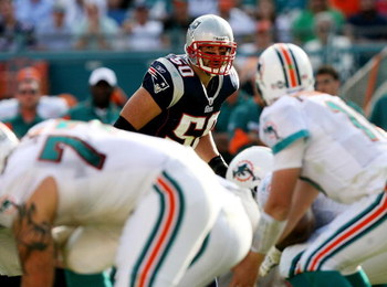 MIAMI - NOVEMBER 23:  Linebacker Mike Vrabel #50 of the New England Patriots looks in as quarterback Chad Pennington #10 of the Miami Dolphins prepares to take the snap at Dolphin Stadium on November 23, 2008 in Miami, Florida. The Patriots defeated the D