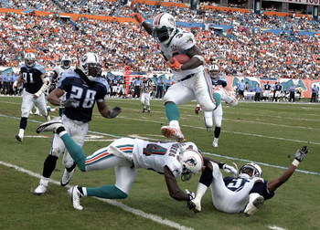 MIAMI - DECEMBER 24:  Running back Ricky Williams #34 of the Miami Dolphins goes airborne for a first down against the Tennessee Titans in the second quarter on December 24, 2005 at Miami Dolphins Stadium in Miami, Florida.  (Photo by Eliot J. Schechter/G
