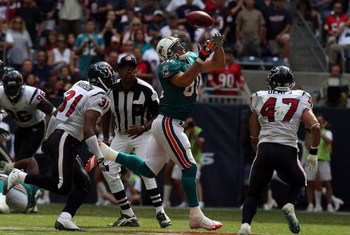 HOUSTON - OCTOBER 12:  Tight end Anthony Fasano #80 of the Miami Dolphins drops a pass against the Houston Texans at Reliant Stadium on October 12, 2008 in Houston, Texas.  (Photo by Ronald Martinez/Getty Images)