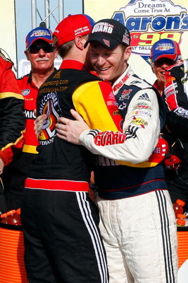 TALLADEGA, AL - APRIL 26:  Dale Earnhardt Jr. (R), driver of the #88 National Guard/Amp Energy Chevrolet, congratulates Brad Keselowski (L), driver of the #09 Miccosukee Chevrolet, in victory lane after winning the NASCAR Sprint Cup Series Aaron's 499 at