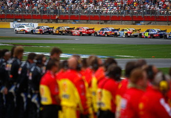 CONCORD, NC - MAY 25:  Crew members stand on the pit road during a red flag for the national moment of silence during the NASCAR Sprint Cup Series Coca-Cola 600 on May 25, 2009 at Lowe's Motor Speedway in Concord, North Carolina.  (Photo by Jason Smith/Ge