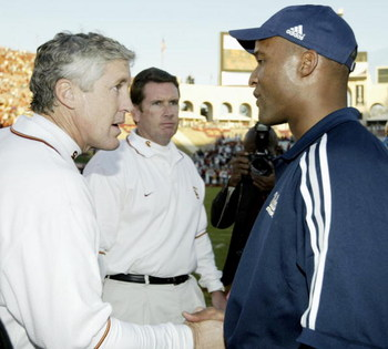 LOS ANGELES - NOVEMBER 22:  Head coach Pete Carroll of UCLA and head coach Karl Dorrell of USC shake hands after the game at the Los Angeles Memorial Coliseum on November 22, 2003 in Los Angeles, California.  USC defeated UCLA 47-22. (Photo by Todd Warsha