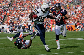 DENVER - SEPTEMBER 14:  Chris Chambers #89 of the San Diego Chargers eludes Calvin Lowry #37 of the Denver Broncos for a 48 yard second quarter touchdown during NFL action at Invesco Field at Mile High on September 14, 2008 in Denver, Colorado.  (Photo by