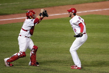 ST LOUIS, MO - OCTOBER 27:  Closing pitcher Adam Wainwright #50 and catcher Yadier Molina #4 of the St. Louis Cardinals celebrate the final out of their 4-2 victory to win the World Series against the Detroit Tigers during Game Five of the 2006 World Seri