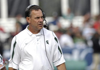 ORLANDO, FL - JANUARY 1: Coach Mark Dantonio of the Michigan State Spartans directs play against the Georgia Bulldogs at the 2009 Capital One Bowl at the Citrus Bowl on January 1, 2009 in Orlando, Florida.  (Photo by Al Messerschmidt/Getty Images)