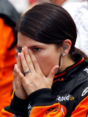 INDIANAPOLIS - MAY 24:  Danica Patrick, driver of the #7 Boost Mobile/Motorola Andretti Green Racing Dallara Honda, prepares to enter her car prior to the start of the IRL IndyCar Series 93rd running of the Indianapolis 500 on May 24, 2009 at the Indianap
