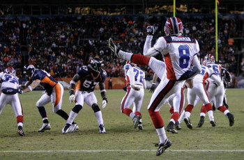 DENVER - DECEMBER 21:  Punter Brian Moorman #8 of the Buffalo Bills punts the ball from his own endzone against the Denver Broncos at Invesco Field at Mile High on December 21, 2008 in Denver, Colorado. The Bills defeated the Broncos 30-23.  (Photo by Dou