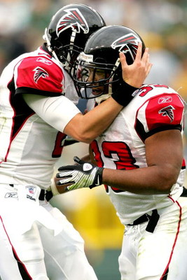 GREEN BAY, WI - OCTOBER 05:  Quarterback Matt Ryan #2 of the Atlanta Falcons celebrates a touchdown late in the fourth quarter with Michael Turner #33 against the Green Bay Packers at Lambeu Field October 5, 2008 in Green Bay, Wisconsin.  (Photo by Matthe