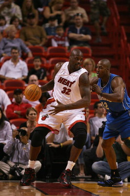 MIAMI - MARCH 18:  Shaquille O'Neal #32 of the Miami Heat goes up against Dwight Howard #12 of the Orlando Magic during the game at American Airlines Arena on March 18, 2007 in Miami, Florida.  The Magic won 97-83.  NOTE TO USER: User expressly acknowledg